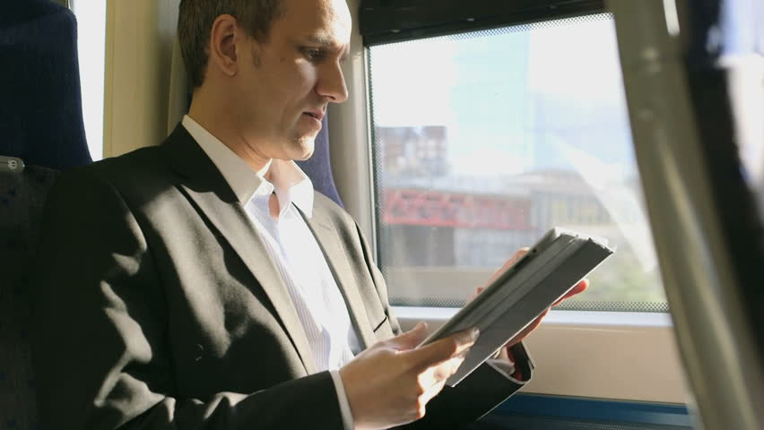 MS Business Man types into his ipad/digital tableton a train | Shutterstock HD Video #6173099