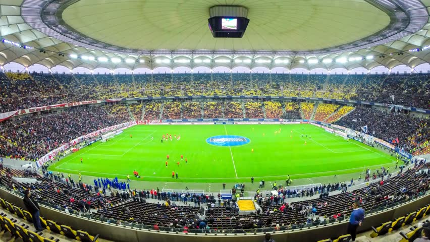 BUCHAREST - APRIL 17: Time lapse of National Arena stadium seats filling up with crowd of soccer fans during a match between Dinamo and Steaua Bucharest. On April 17, 2014 in Bucharest, Romania