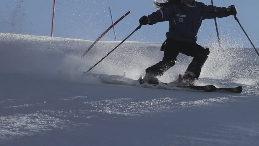 Slow motion total shot of skier carving fast down the wide