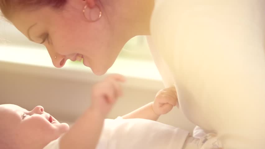 Mother and her Newborn Baby. Happy Mother and Baby kissing and hugging. Resting together. Maternity concept. Parenthood. Motherhood Beautiful Happy Family Footage. Full HD 1080 Slow Motion 240 fps - HD stock video clip