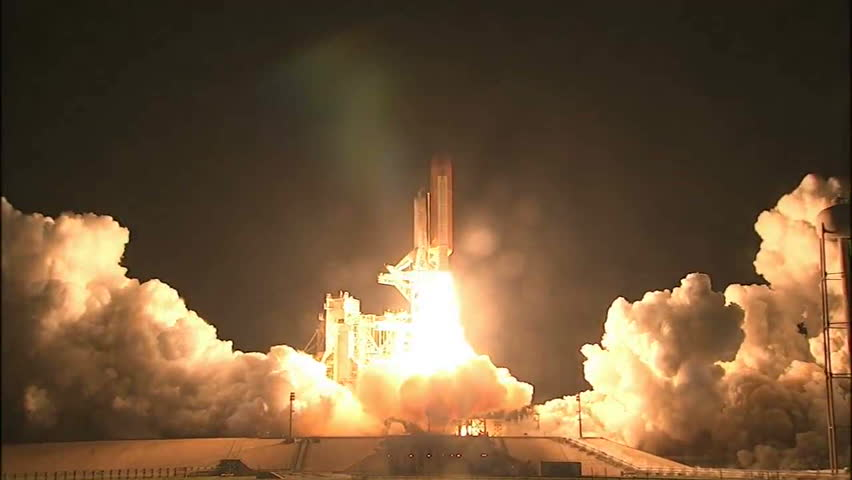 CIRCA 2010s - The Space Shuttle Discover launches at night.