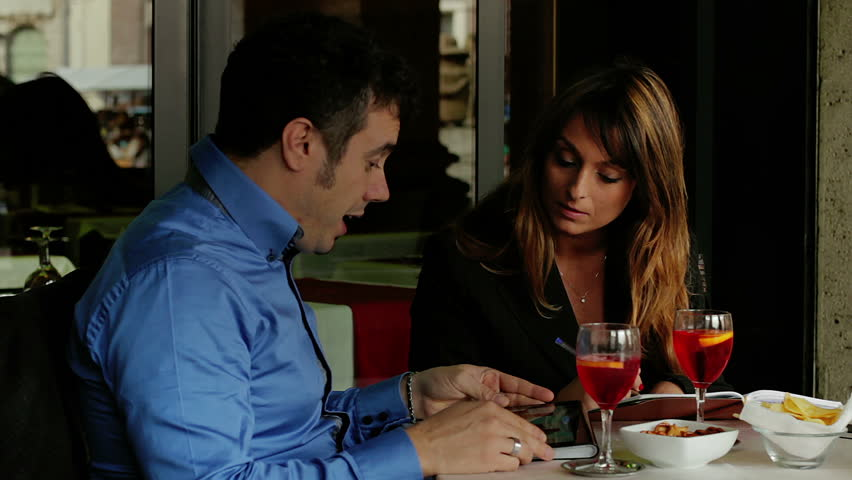 Business meeting. Businesswoman and businessman in cafe, talking. - HD stock video clip