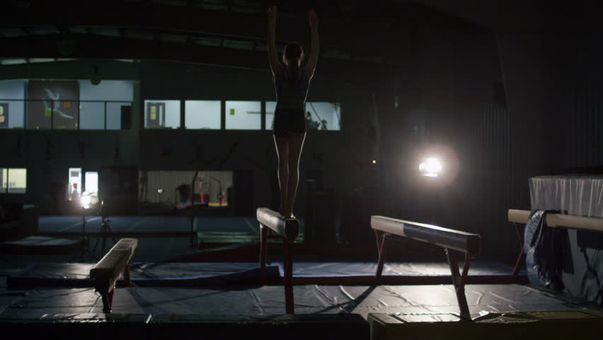 Young Female Gymnast Practicing for Competition with Advanced Acrobatics