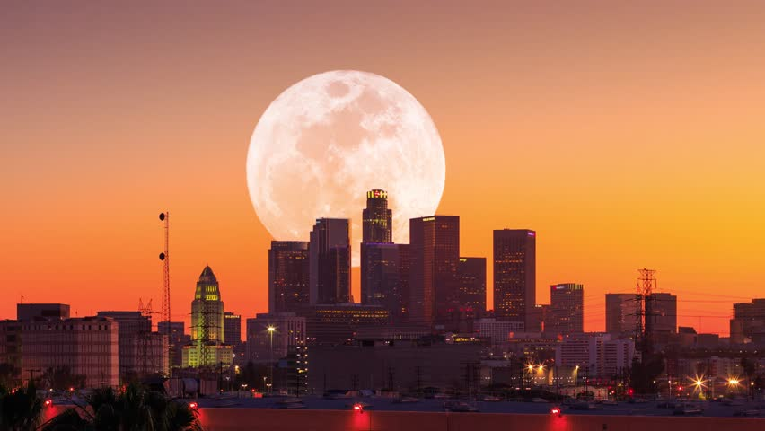 4K UHD. Big full moon rising behind downtown Los Angels city skyline. Timelapse.