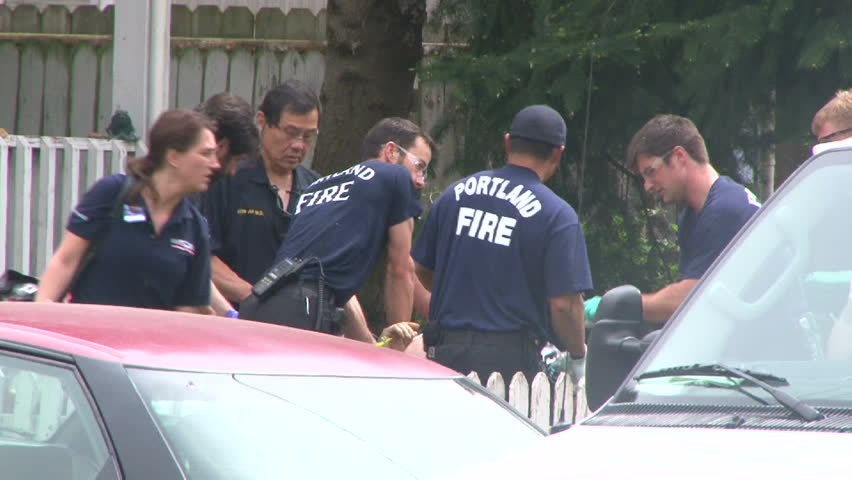 PORTLAND, OREGON - CIRCA 2014: Ambulance with team of paramedics responding to house call in neighborhood with person suffering from heart attack.