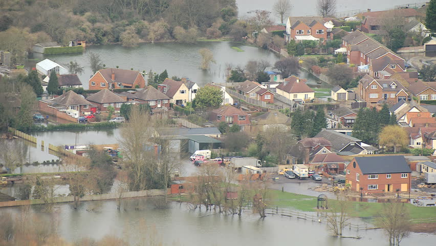 Environmental damage by flooding, Surrey, UK - Aerial view of natural disaster homes and businesses flooded Thames Valley Surrey, Southwest England, UK