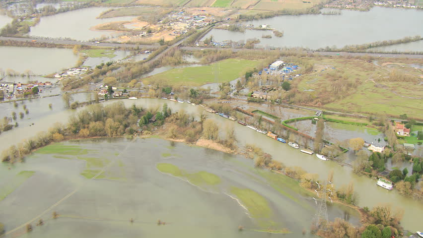 Flooding environmental disaster, Thames Valley, UK - Aerial view of server environments damage by floodwater bust river banks, Thames Valley, Surrey, UK