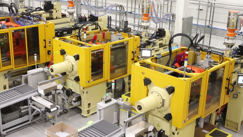 Close up of the mold of an injection molding machine making plastic parts in a factory | Shutterstock HD Video #6311060
