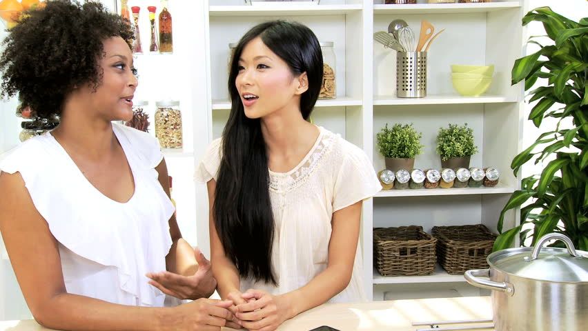 Multi Ethnic Girlfriends Talking Home Kitchen - Happy young African American Asian Chinese girlfriends talking laughing together home kitchen close up