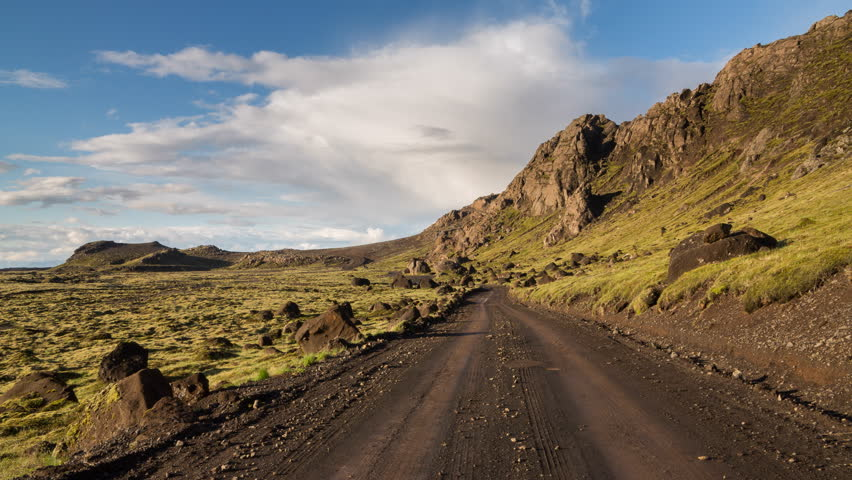 4K Version of Time Lapse of the expansive moss-covered lava fields and track in Iceland