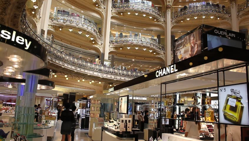 PARIS, FRANCE - SEPTEMBER 4 : inside part of the famous Galeries Lafayette with it's brand stands, customers and vendors on September 4th 2013 in Paris, France