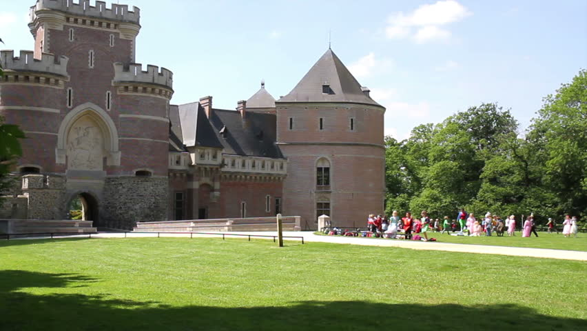 Chldren playing near the Medieval Castle.  (Gaasbeek, Belgium). - HD stock footage clip