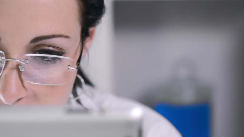 close up of lab technician using tablet computer - HD stock video clip