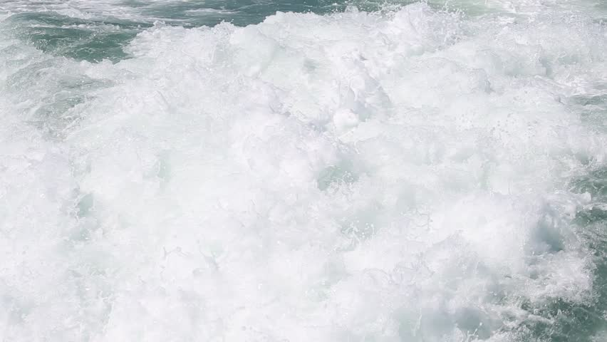 Blue ocean sea water wave with fast yacht boat wake foam of prop wash - HD stock footage clip