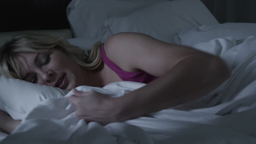 Woman with insomnia in bed at night  - 4K stock footage clip