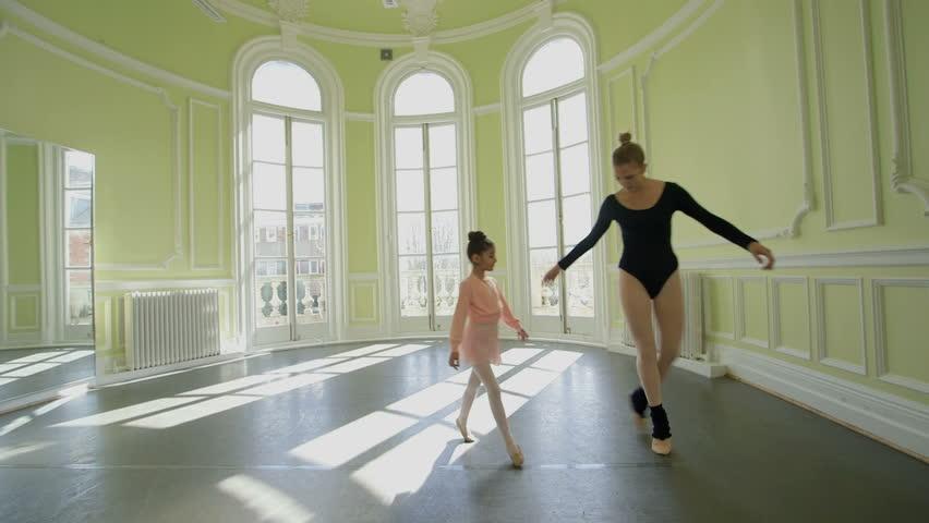 Female Ballet Dancer Leads Three Young Ballerinas