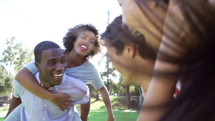 Slow Motion Sequence Of Friends Having Fun In Park Together