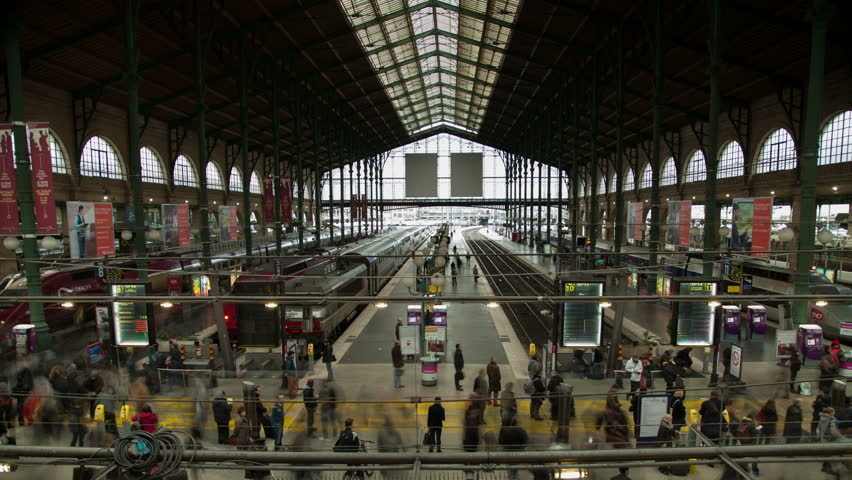 Rush hour in busy trainstation. Gare Du Nord 4K time-lapse. Masses of people are crowding forwards to get on their trains in time before departure. From 'Gare du nord' in Paris. | Shutterstock HD Video #6448121
