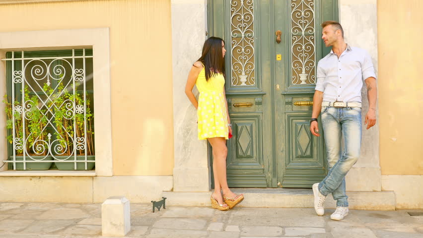 Couple standing against a building    Shutterstock HD Video #6450551