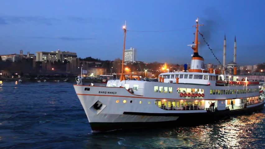 ISTANBUL - DEC 21, 2010: BARIS MANCO ferry sails in to the night at Kadikoy. Nearly 150,000 passengers use ferries daily in Istanbul, due to easy access to two different continents.