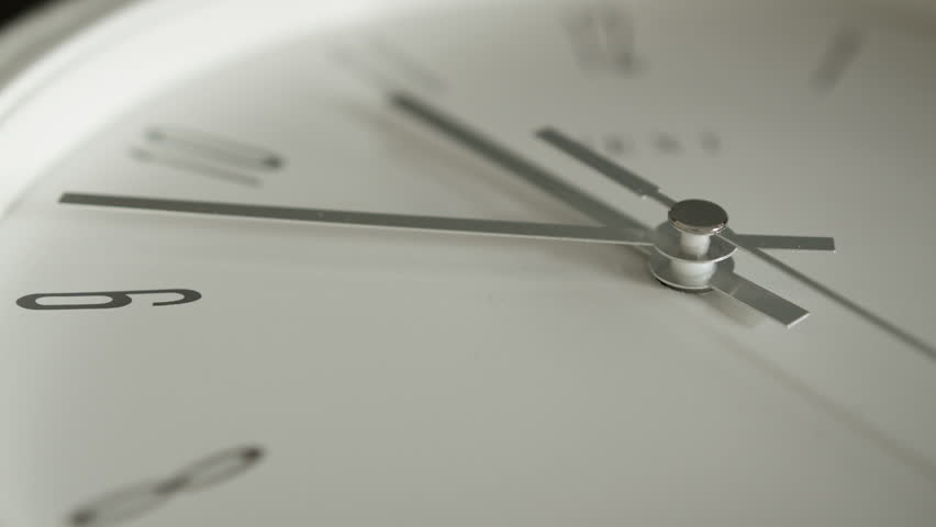 White clock face HD stock footage. Close up of a white clock face suggesting the passing of time. | Shutterstock HD Video #6455681