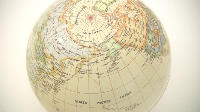 Video footage (not 3d animation) of a globe spinning - northern hemisphere.