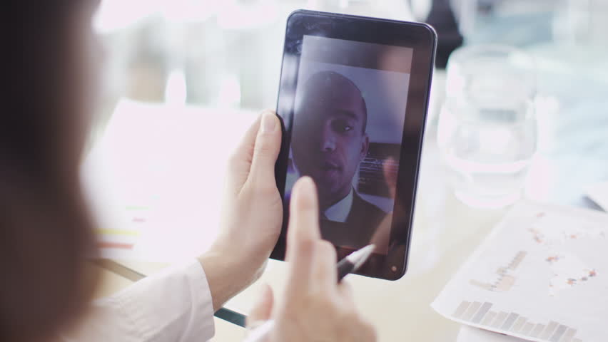 Office workers have meeting on tablet - HD stock footage clip