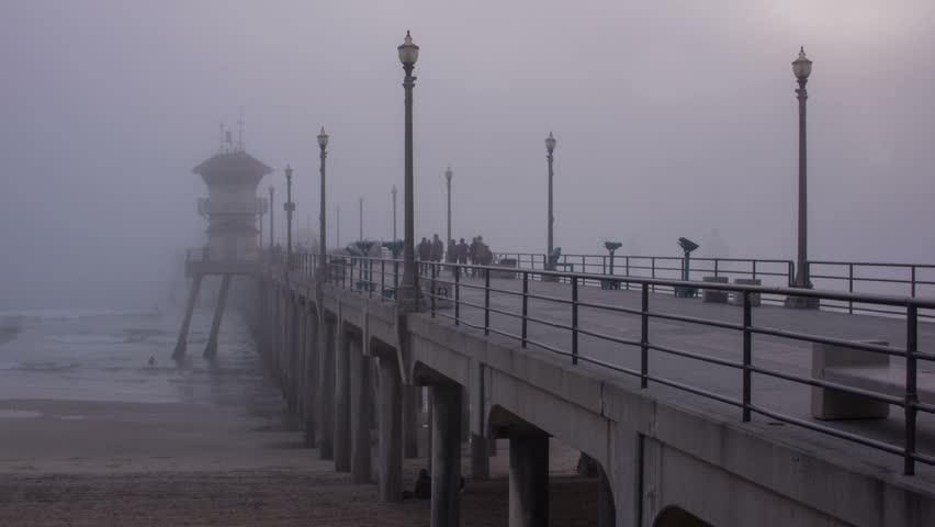 Time lapse video shows dark fog covering the huntington for Huntington beach pier fishing