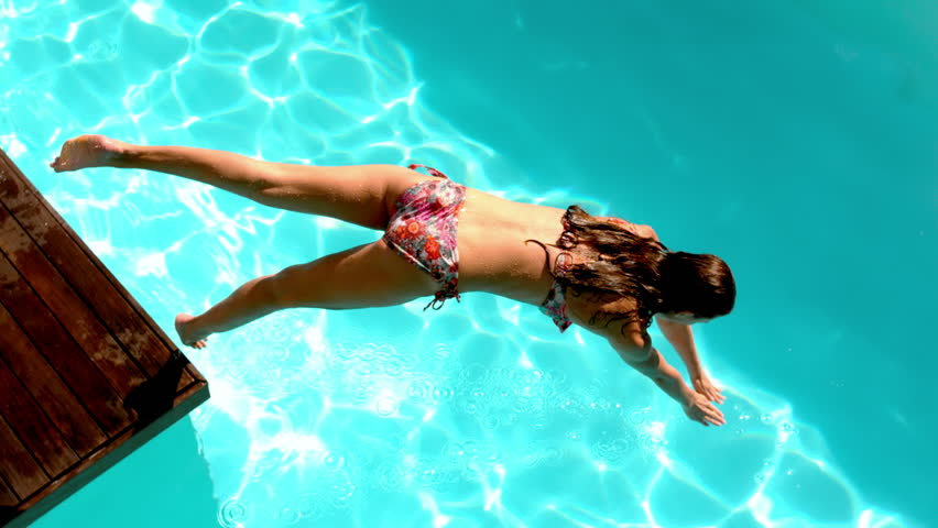 Brunette diving in the swimming pool in slow motion - HD stock footage clip