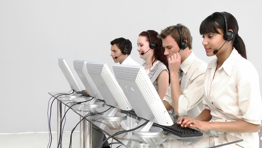 Multi-ethnic business people working in a call center with headset on - HD stock video clip