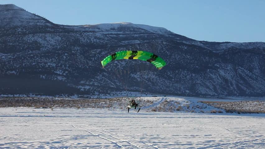 MORONI, UT- CIRCA JAN 2010: Steve Pelton of Moroni lands in Powered parachute circa Jan 2010 in Moroni, Utah, USA.Powered parachute landing past friends on ice. - HD stock footage clip