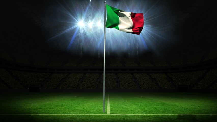 Italy national flag waving on flagpole against football pitch with spotlights and flashes - HD stock video clip