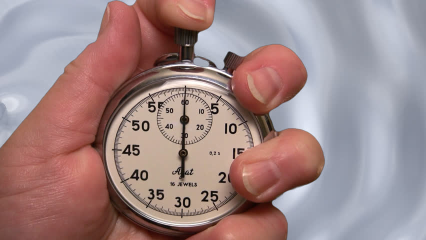stopwatch against a flowing silver background - HD stock footage clip