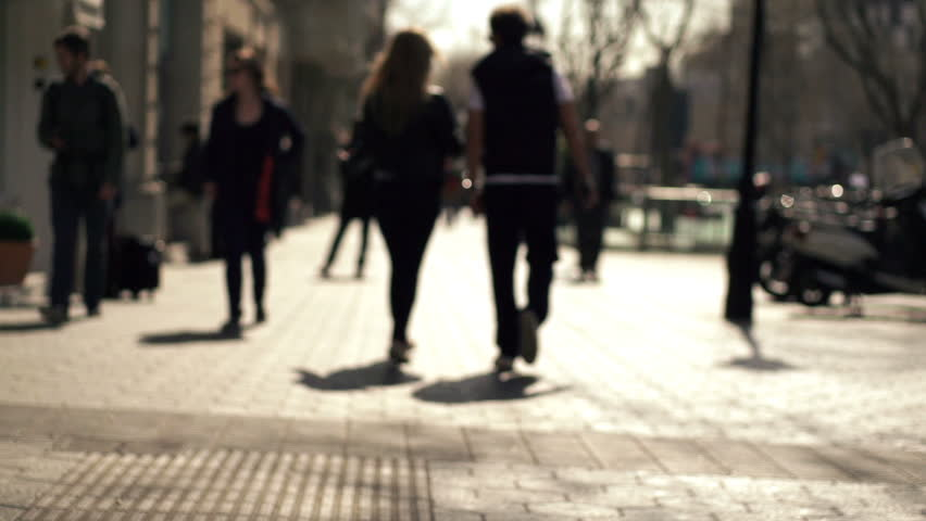 Silhouette of people walking in the city, super slow motion, shot at 240fps  - HD stock video clip