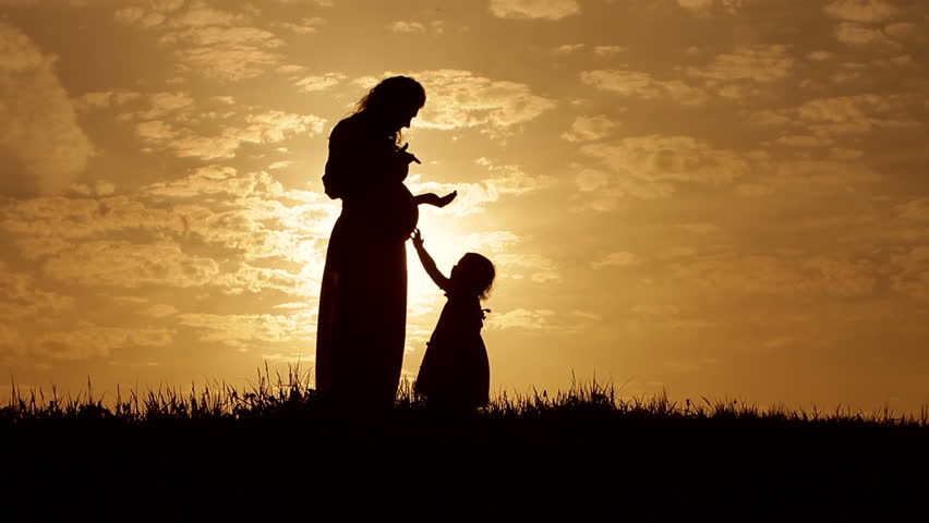 Silhouettes young mother and  her 3 year old daughter at sunset | Shutterstock HD Video #6584183