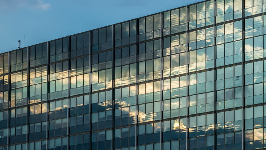 Clouds reflection on a glass facade - modern office Building - Hamburg - DSLR time lapse | Shutterstock HD Video #6593327