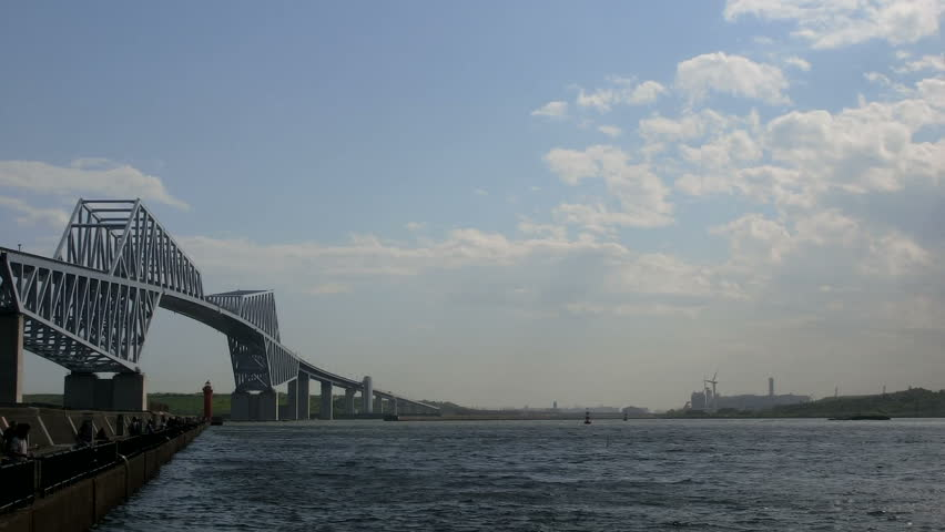 Cloud action over clear skies and rapid transportation surrounding the Tokyo Gate Bridge by Tokyo Bay. Timelapse. | Shutterstock HD Video #6595298