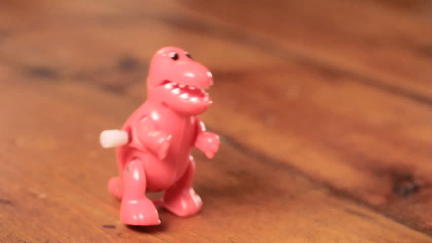 Classic toy dinosaur walking plastic wind-up t-rex  - HD stock footage clip