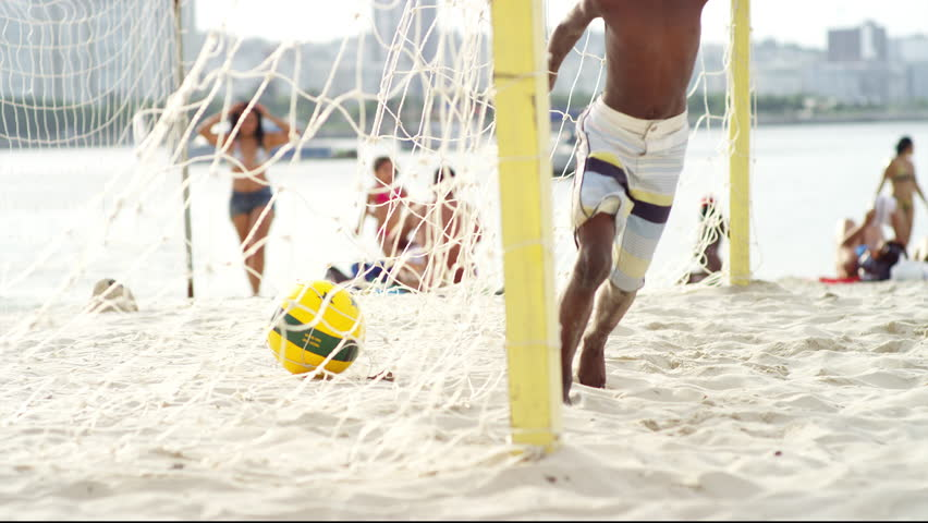 Kids celebrating a goal on the beach