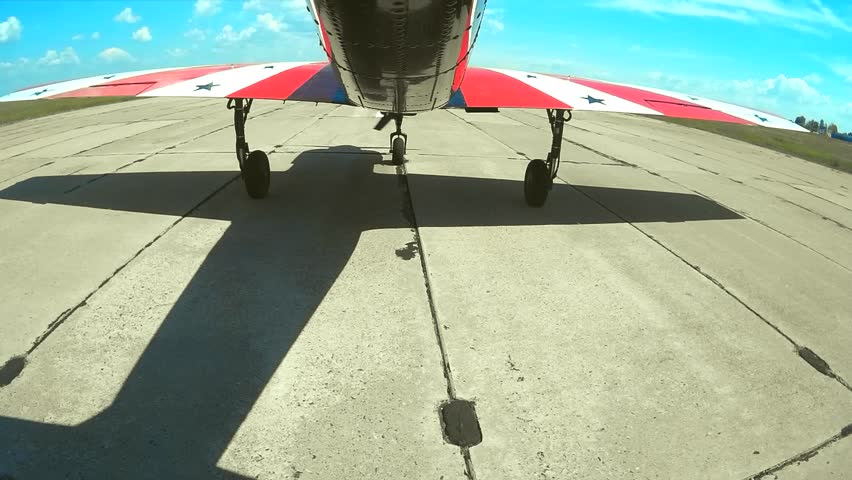 Small plane takes off from the concrete runway