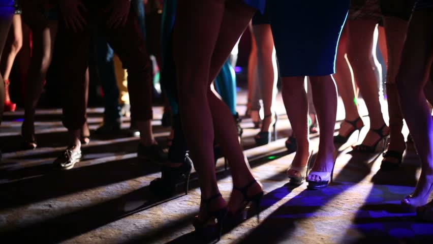 Slender legs young women have fun and dance at party in night club - HD stock footage clip
