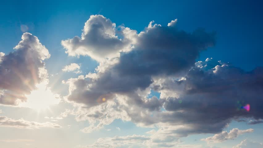 Time lapse clip. HD video (High Definition). White fluffy clouds in the blue sky.