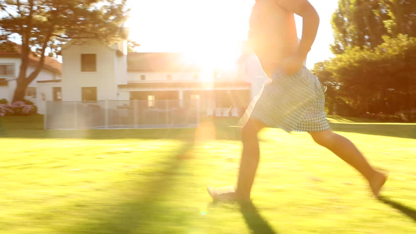 Child running during golden hour with flare | Shutterstock HD Video #6675218
