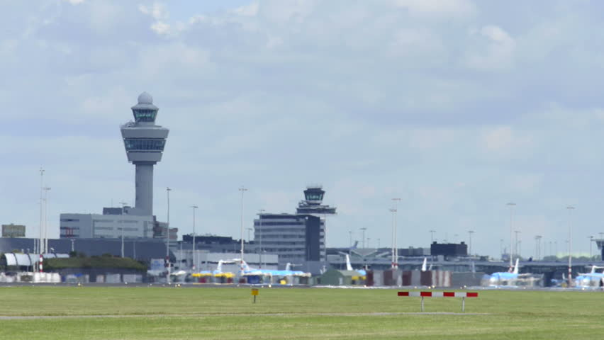 AMSTERDAM, THE NETHERLANDS - JUNE 22: KLM airplane landing at Schiphol airport near Amsterdam, The Netherlands.