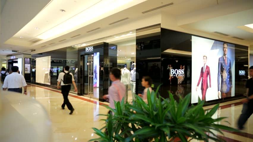 KUALA LUMPUR, MALAYSIA - CIRCA JUNE 2014: Hugo Boss outlet, Suria KLCC, Petronas Towers. Hugo Boss is a German luxury fashion and style house based in Metzingen, Germany.