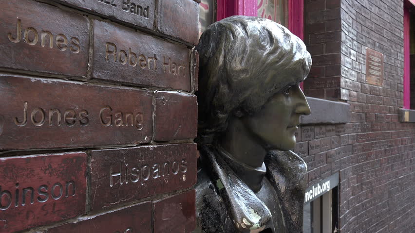 LIVERPOOL, MERSEYSIDE/UK - JUNE 30, 2014: Close up of John Lennon statue, The Beatles in Mathew Street. Mathew Street is known worldwide as the location of the Cavern Club where the Beatles played.