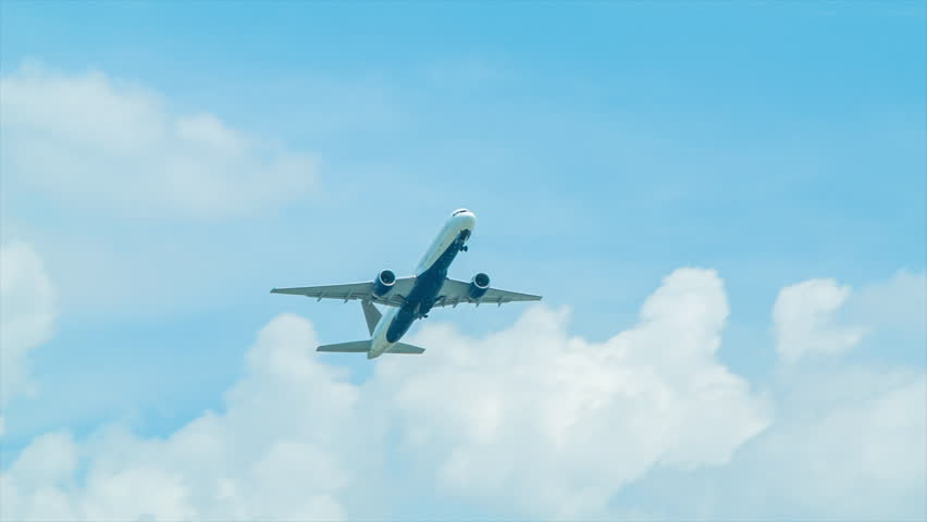 Jet Airliner Taking-off into Blue Sky with White Clouds