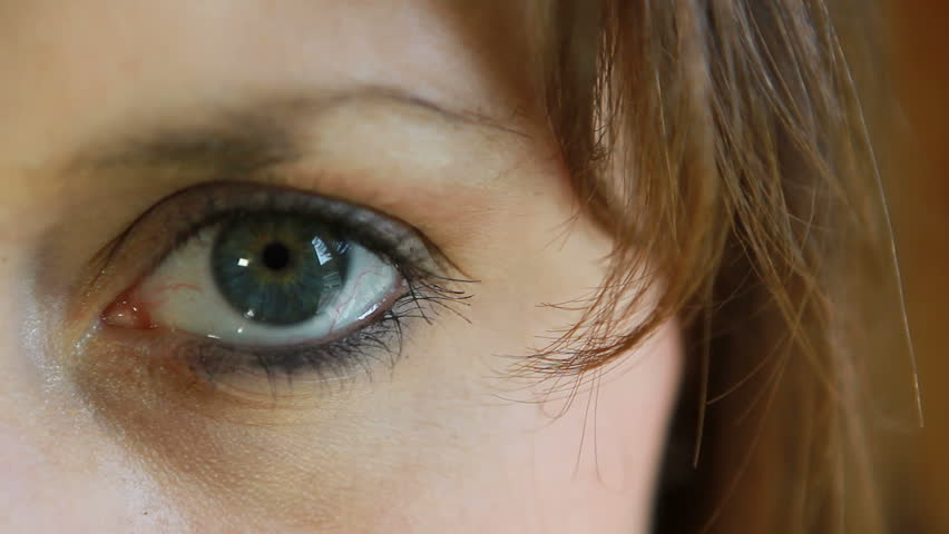 A close-up of a woman's big beautiful eye. - HD stock footage clip