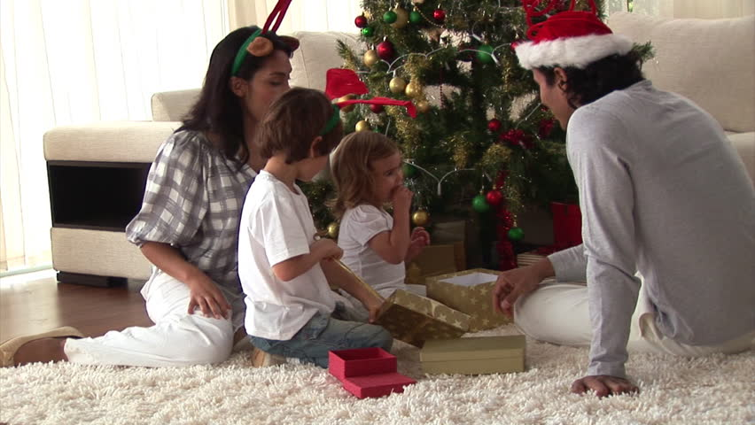 Happy family discovering the gifts on Christmas day at home - HD stock video clip