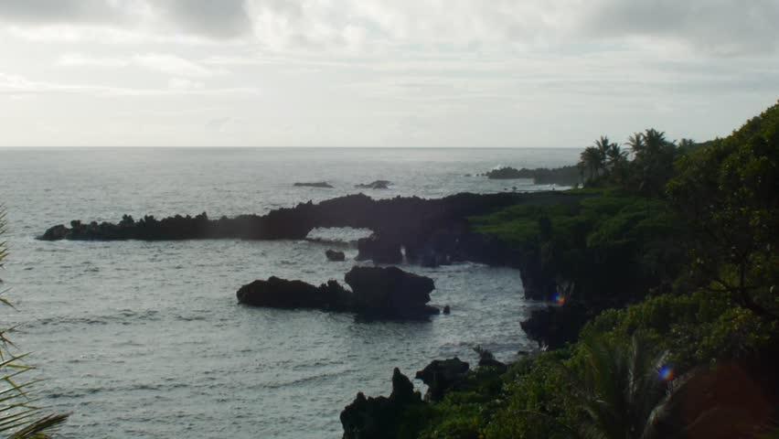 Waianapanapa State Park, Hawaii - May, 2014 - Wide shot of a natural arch rock formation in Waianapanapa State Park.